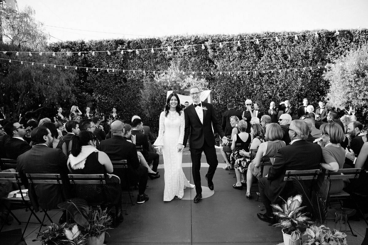 a-boho-chic-wedding-at-the-fighouse-in-los-angeles-bride-wearing-simple-lace-gown