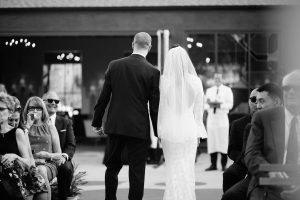 the-bride-and-groom-walks-from-the-alter-facing-thrir-guests-at-the-fighouse-venue-in-los-angeles