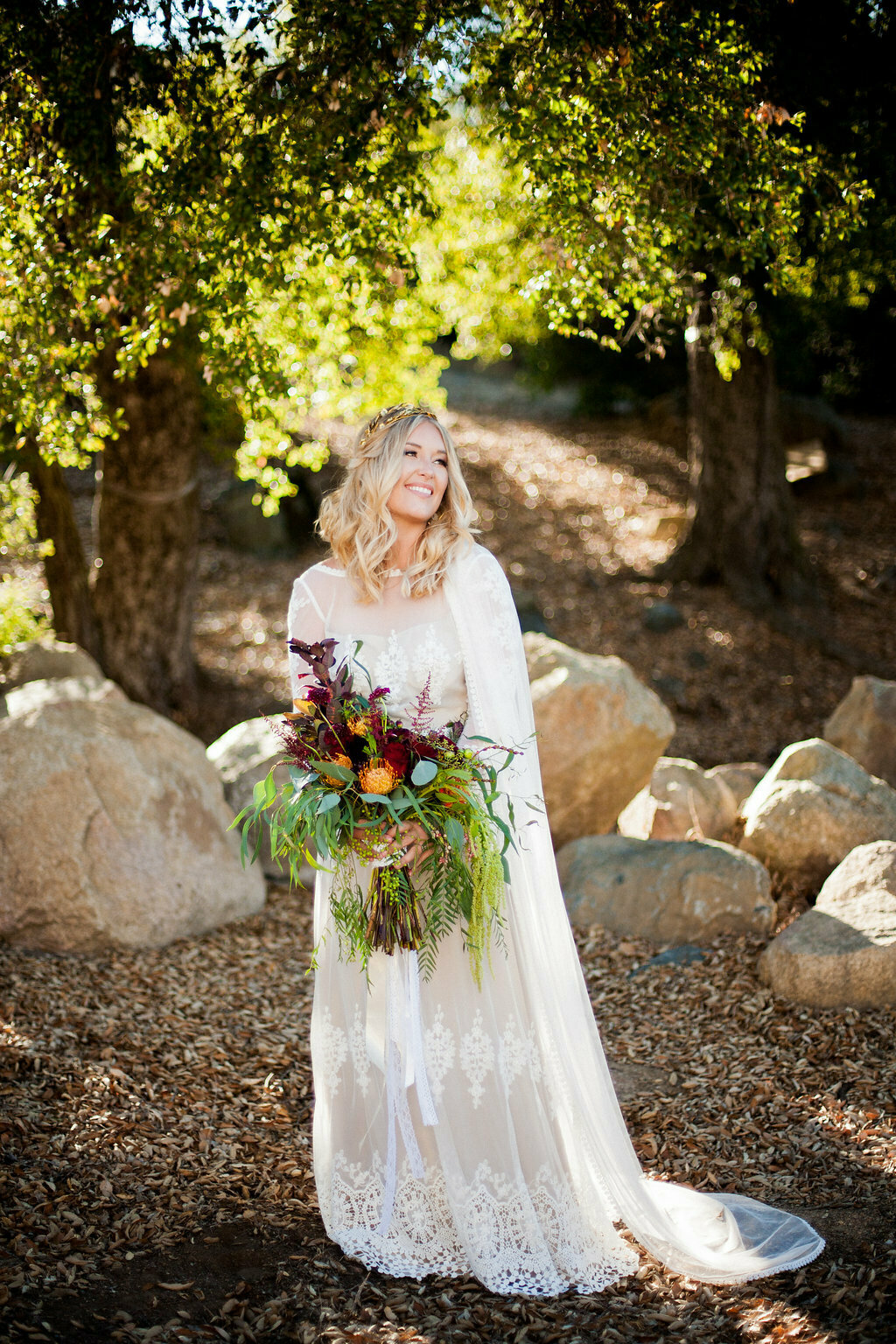 bride-medan-holding-an-oversized-bouquet-dressed-in-a-long-sleeved-lace-vintage-style-wedding-dress