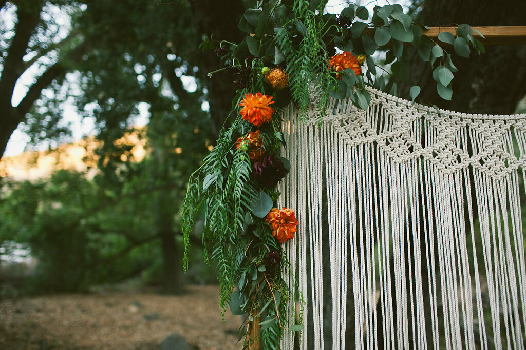 macrame-wedding-altar-backdrop-with-fresh-florals-added