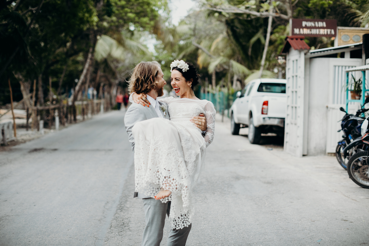 bride-Caroline-bohemian-chic-tulum-wedding-here-swept-up-by-her-groom-wearing-a-backless-lace-dress