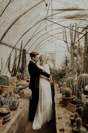 bride-julie-hug-her-husband-palm-springs-wedding-inspiration