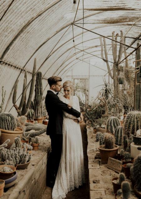 bride-julie-hug-her-husband-palm-springs-wedding-inspiration