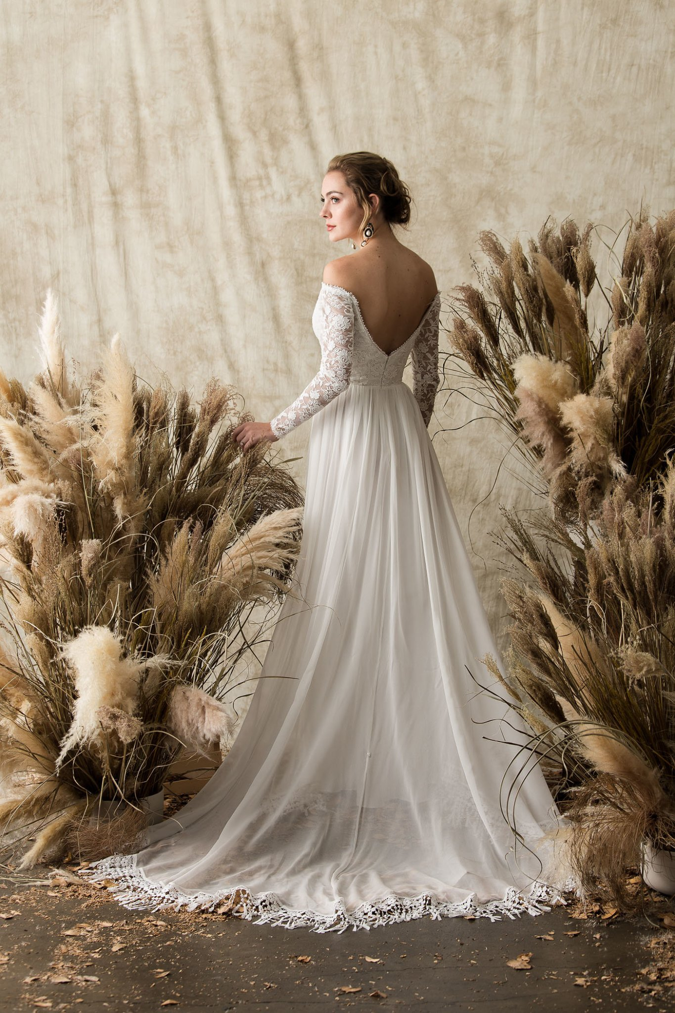 gabrielle-low-back-long-sleeve-lace-wedding-dress-bohemian-fringe-hem-long-sleeves