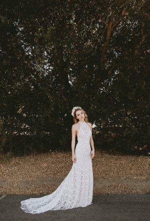 dreamers-lovers-simple-classic-wedding-dress-with-fringed-hem-and-cutaway-neckline-made-in-la