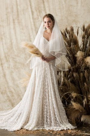 a-bohemian-simple-lace-wedding-dress-shown-with-elbow-length-blusher-veil