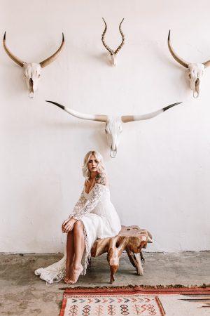 Gabrielle-off-white-long-sleeves-wedding-dress-off-shoulder-sweetheart-neckline-dream-flowy-skirt-fringed-tassel-hem