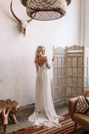 Gabrielle-lce-and-silk-off-shoulder-long-sleeve-wedding-dress-flowy-skirt-with-fringed-hem