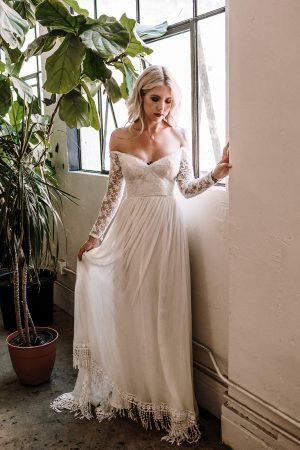 Gabrielle-sweetheart-neckline-off-shoulder-long-sleeve-wedding-dress-fringe-hem-dreamy-long-train