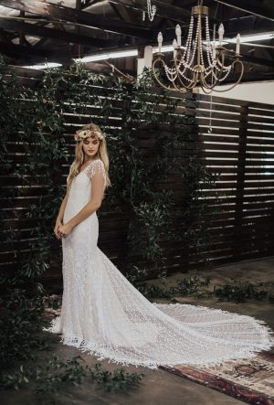 Jenny-floral-and-dotted-lace-bohemian-wedding-dress-featuring-fringed-straps-and-long-train