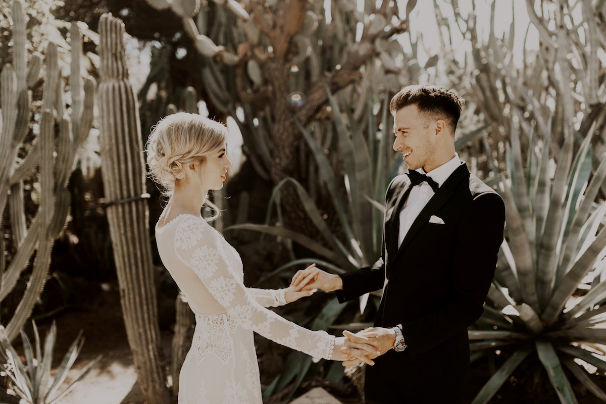 bride-and-groom-in-front-of-cactuses-palm-springs-california