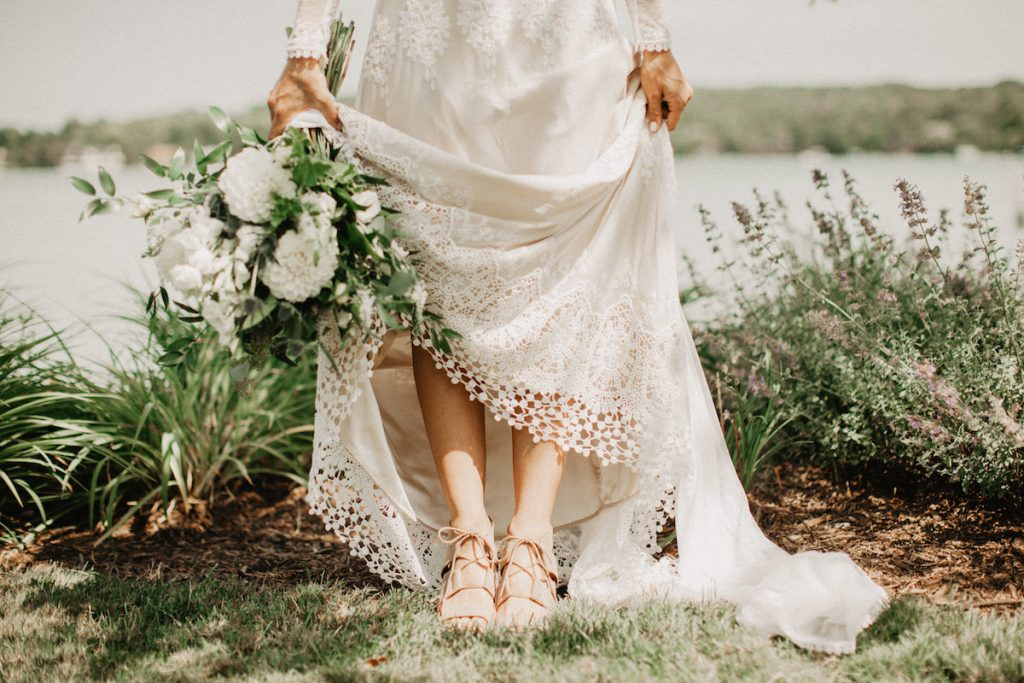 bride-styling-inspiration-nude-sandals-is-the-perfect-accessory-for-this-textured-lace-flowy-boho-wedding-dress