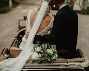 even-the-bride-who-is-antiveil-will-love-this-bride's-veil-with-her-backless-bohemian-lace-wedding-dress