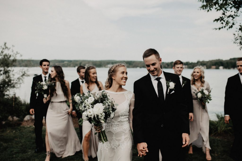 moments-of-bliss-bride-with-bridal-party-at-their-lakefront-bohemian-wedding