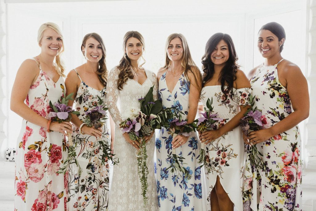 bride-Jen-and-her-bridesmaids-posed-for-photos-wearing-sloral-bohemian-bridesmaid-dresses-in-different-colors