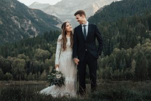 real-bride-in-Utah-mountains-wearing-lisa-long-sleeve-modest-wedding-dress