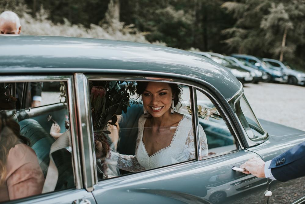 bride-lauren-in-vintage-car-at-hyde-estates