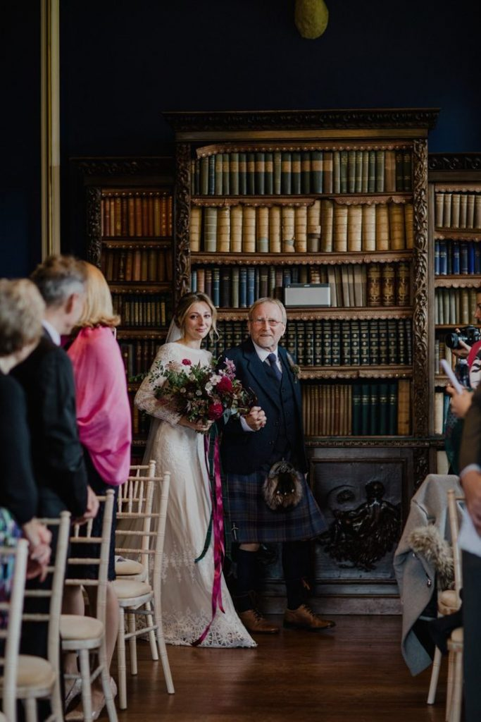 boho-bride-Ruth-escorted-by-her-father-at-her-non-traditional-wedding-in-Scotland's-cambo-estate