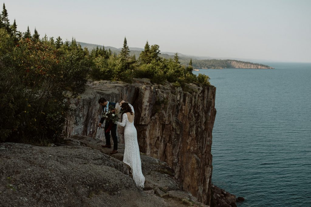 ntimate-lakeside-wedding-at-lake-superior-bride-wearing-long-sleeve-backless-dress