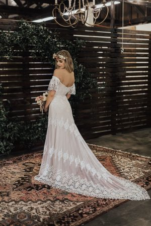 Carrie-lace-wedding-dress-with-plunge-back-low-cut-neckline-long-train-and-flutter-sleeves