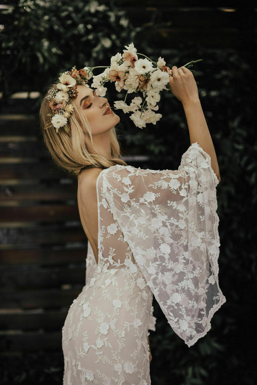 Samantha-angel-sleeves-wedding-dress-in-off-white-lace-with-long-dreamy-train-and-built-in-corset