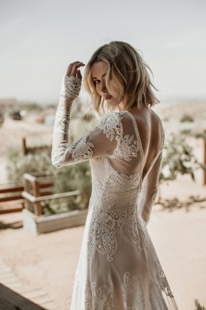 the-flattering-celeste-wedding-dress-with-fitted-waistband-low-cut-back-and-long-sleeves-along-with-a-soft-aline-skirt-with-train