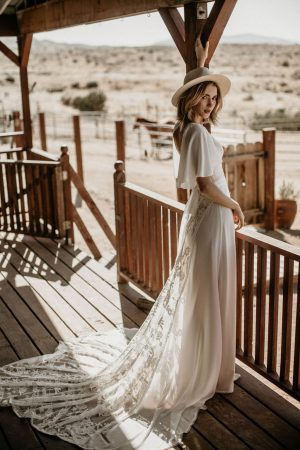 Hayley-lace-and-crepe-romantic-wedding-dress-with-cape-sleeves-dreamy-train-and-low-cut-neckline