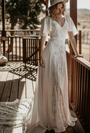 Hayley-lace-and-crepe-romantic-bohemian-wedding-dress-with-belted-waist-mixed-fabric-design-and-cape-sleeves
