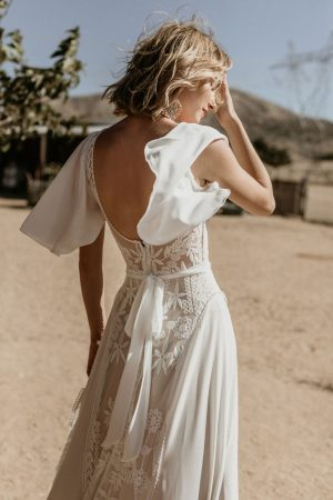 Plunge-back-Hayley-lace-and-crepe-romantic-wedding-dress-with-flowy-cape-sleeves