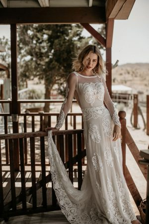 the-Isabella-lace-gown-featuring-long-sleeves-open-back-and-romantic-flowy-skirt