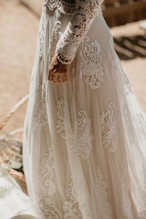 close-up-detailing-of-Isabella-applique-mesh-lace-gown-and-scalloped-hem