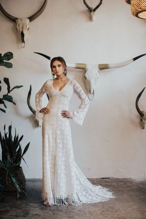 marie-off-white-lace-wedding-dress-with-long-bell-sleeves-fringe-hem-and-fitted-silhouette