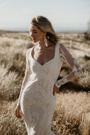 Violetta-unique-lace-wedding-dress-with-open-back-long-sleeves-and-dreamy-train-a-boho-bride's-dream
