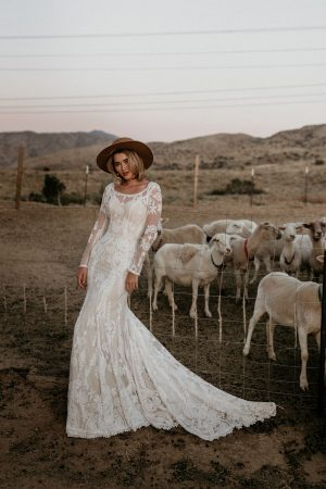 Willow-lace-wedding-dress-with-long-sleeves-cutout-open-back-and-long-train-made-to-your-exact-measurements-in-California