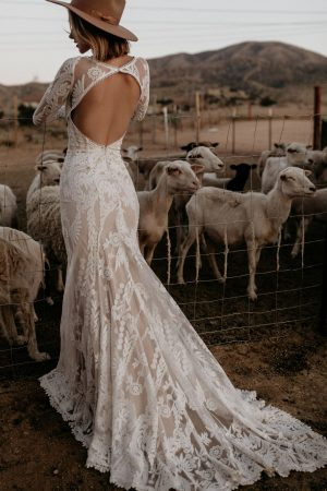 Willow-lace-wedding-dress-with-long-sleeves-cutout-open-back-and-long-train-for-the-bohemian-bride