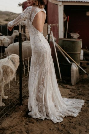 Willow-lace-wedding-dress-with-long-sleeves-cutout-open-back-and-long-train-made-in-California