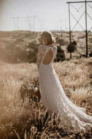 zinnia-romantic-bohemian-wedding-dress-with-long-sleeves-and-open-back-with-the-dreamiest-train