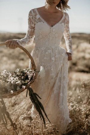close-up-of-the-new-zinnia-romantic-bohemian-wedding-dress-with-long-sleeves-and-open-back