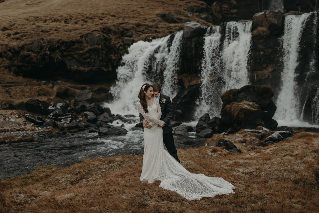 witness-the-romantic-Iceland-elopement-amidst-the-dreamiest-waterfall-the -bride-hikedin-a-polka=dotted-wedding-dress