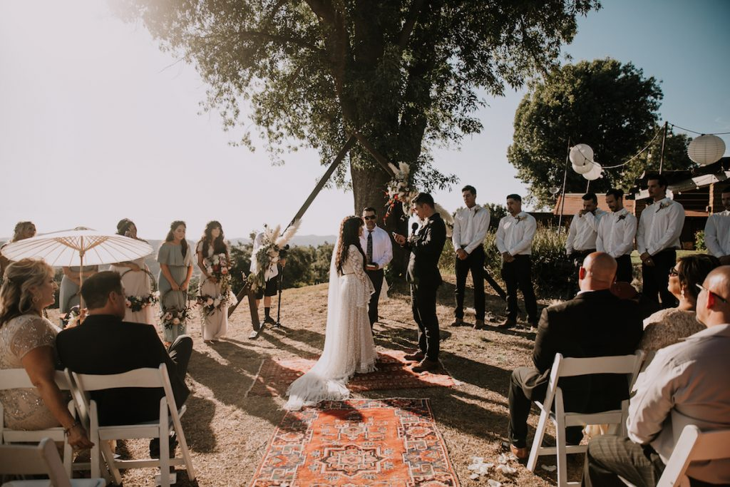 A-Bohemian-Wedding-with-vintage-rug-aisle-at the Condor's Nest Ranch