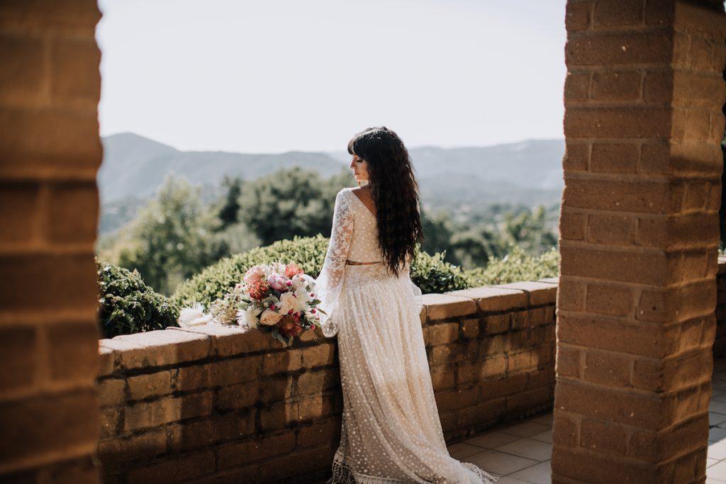 Bride-Amanda-at-the-Condor's-Nest-Ranch-wearing-2-piece-wedding-dress