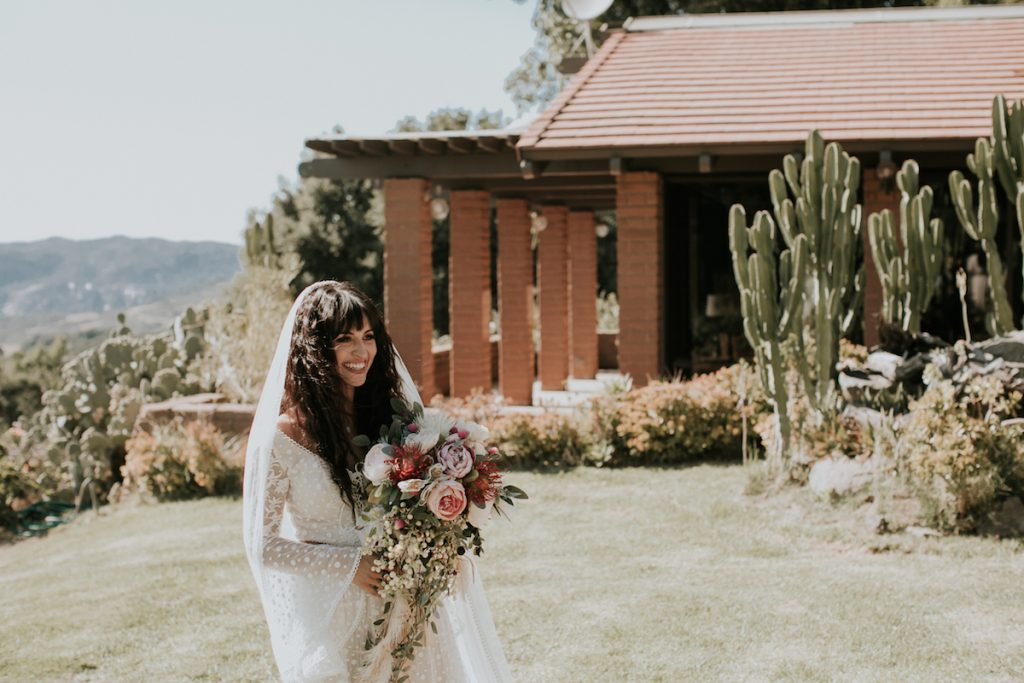 Bride-Amanda-wearing-bohemian-wedding-dress-with-bell-sleeves-at-Condor's-Nest-Ranch