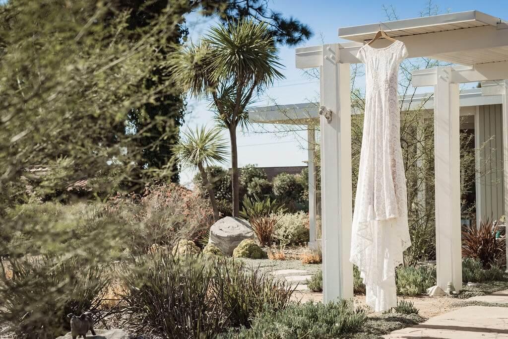 wedding-dress-on-hanger-for-a-backyard-wedding