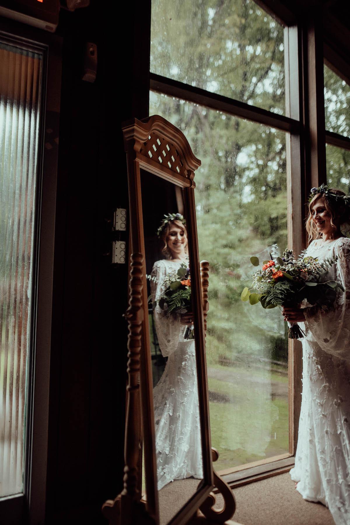 Bride Alison wearing angel sleeve lace wedding dress