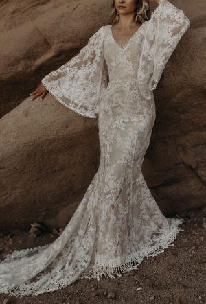 Carissa-Lace-wedding-dress-witth-bell-sleeves-and-fringe-tassel-hem